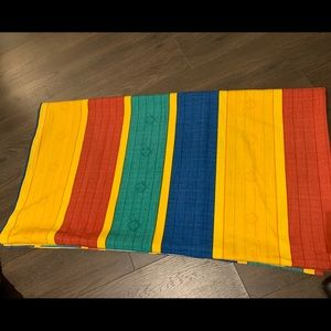 One panel of colourful strappy curtain